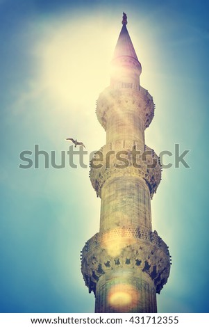 Photo of the dome over blue sky background in sunset light, famous religious landmark, Blue mosque Istanbul or The Sultan Ahmed Mosque, vintage