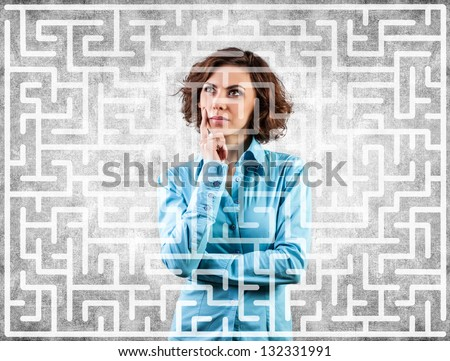 Photo of the girl before a difficult labyrinth - stock photo