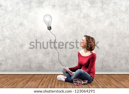 Photo of the girl with a computer in a hand - stock photo