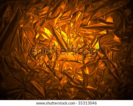 photo of the golden background from crumpled foil - stock photo