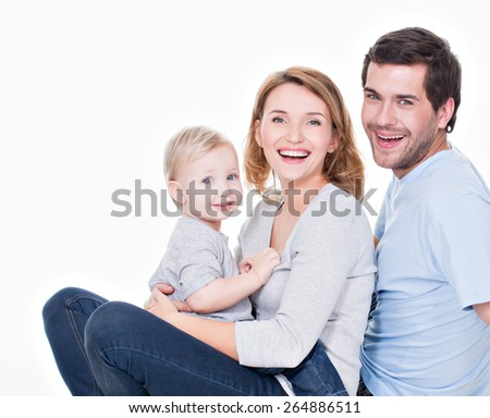 Photo of the happy young family with little child sitting on white background. - stock photo