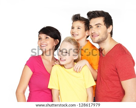 Photo of the happy young family with two children looking side -  isolated on white background - stock photo
