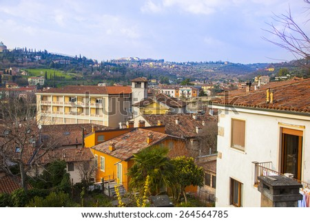 Photo of the Italian town of mountains in the background - stock photo