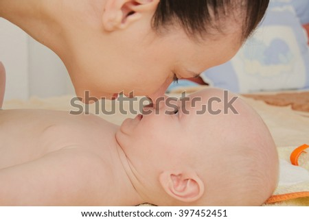 Photo of the Mother playing with hertwo months  baby boy - stock photo