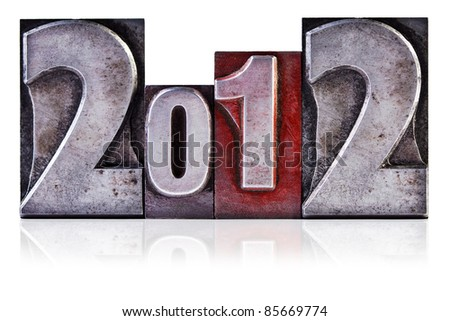 Photo of the number 2012 in old metal letterpress, isolated on a white background. - stock photo