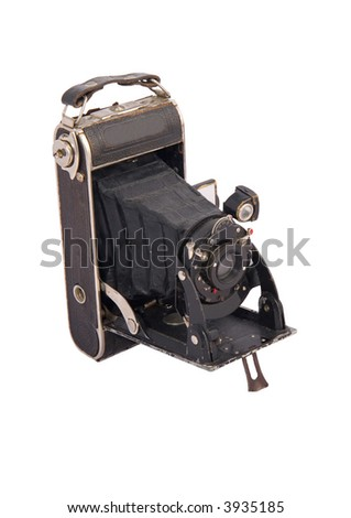 Photo of the old antique camera on the white background