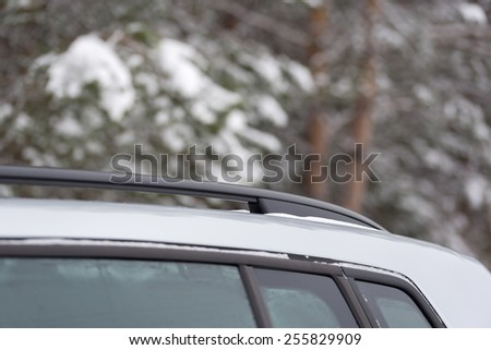 Photo of the part of the car on the background of winter forest - stock photo