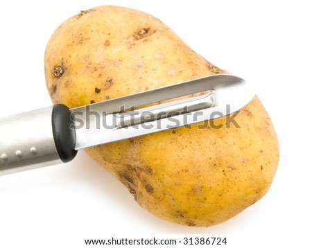 photo of the potato with knife against the white background
