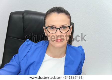 Photo of the Pretty Business woman analyzing investment charts with calculator and laptop