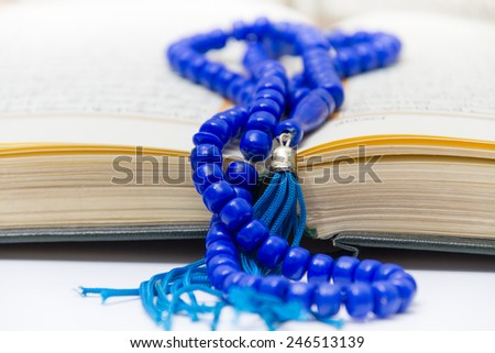 Photo of the Rosary and Qoran - stock photo