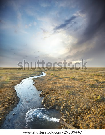 Photo of the sewage discharged from the pipe to the channel - stock photo