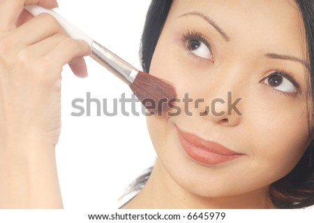 Photo of the smiling woman with face-powder brush - stock photo