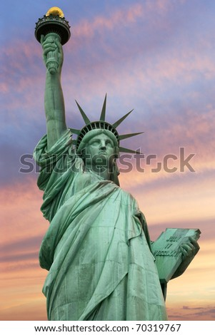 Photo of the Statue of Liberty in New York City under a vivid sky. - stock photo
