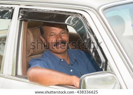 Photo of the taxi driver waiting for a customer