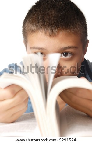 Photo of the young boy with interesting book - stock photo