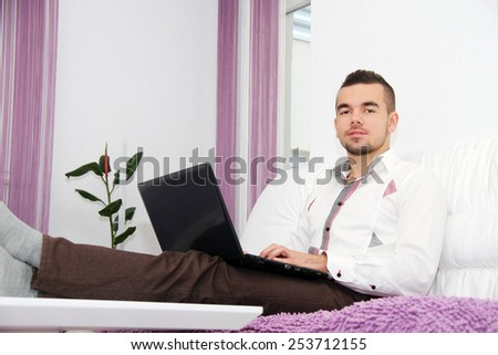 Photo of the Young Business man Using Laptop At Home - stock photo