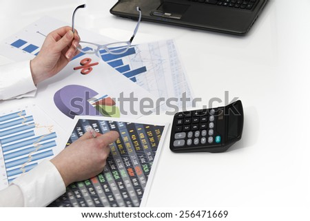 Photo of the Young businesswoman calculating financial documents - stock photo