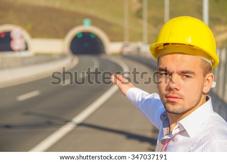Photo of the Young engineer near the tunnel - stock photo