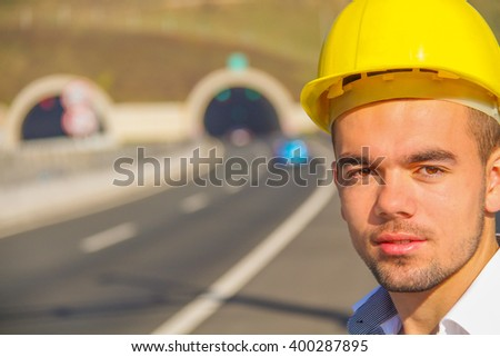 Photo of the Young engineer near the tunnel