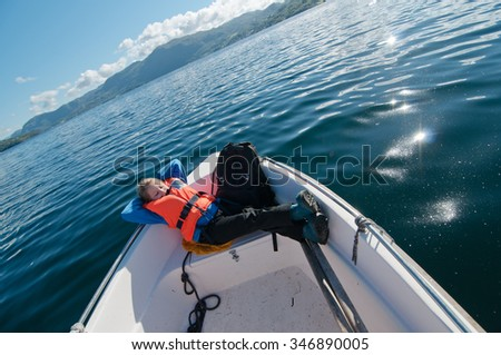 Photo of the young girl lying on a prow of a boat - stock photo