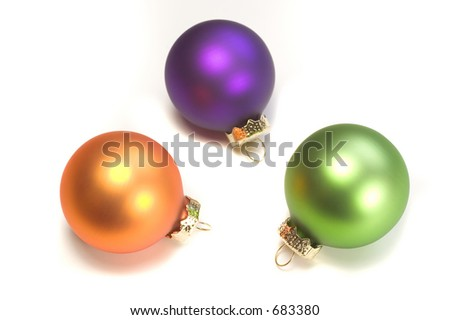 Photo of three Christmas ornaments isolated on white background