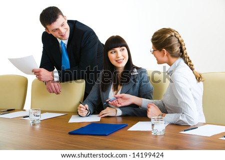 Photo of three professionals discussing conditions of transaction - stock photo