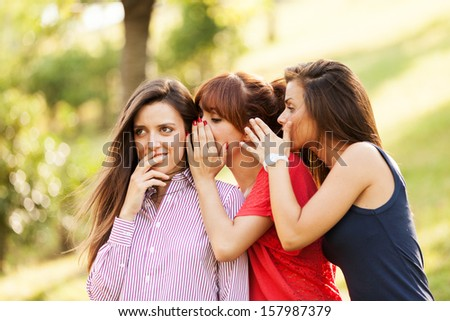 Photo of three whispering woman - stock photo