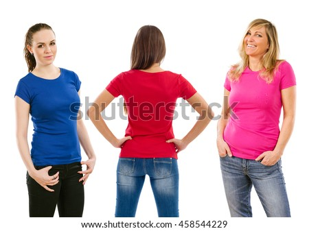 Photo of three women posing with blue, red, and pink blank t-shirts, ready for your artwork or design. - stock photo