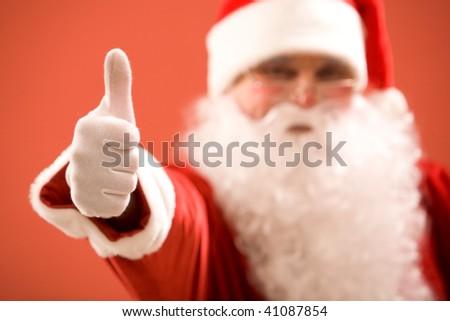 Photo of thumb up shown by Santa Claus - stock photo