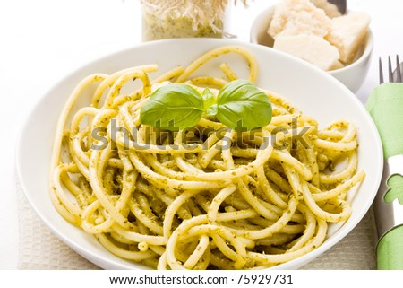 photo of traditional italian food pasta with pesto with different ingredients - stock photo