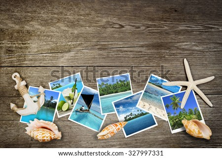 photo of tropical seas and seashells on wooden background - stock photo
