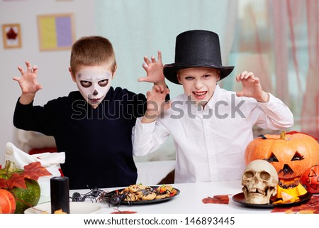 Photo of twin eerie boys looking at camera with frightening look  - stock photo