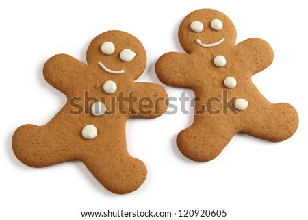 Photo of two baked gingerbread man cookies on a white background. Clipping path included.