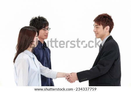 Photo of two business partners shaking hands after signing contract in the office   - stock photo