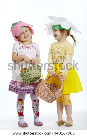 photo of two cute little girls with shopping bags