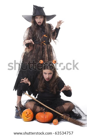 Photo of two girls in halloween costume,  broom and pumpkin and having fun