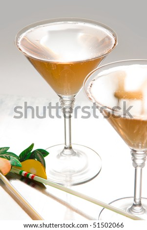 Photo of two glasses of martini on table - stock photo