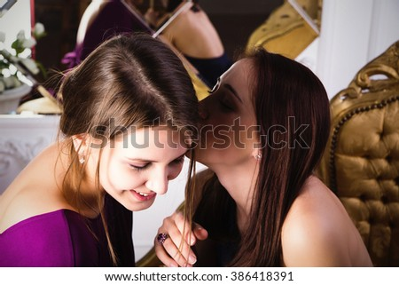photo of two happy young girlfriends talking - stock photo