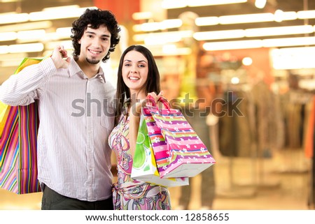 Photo of two people standing on the background of department and looking at camera - stock photo