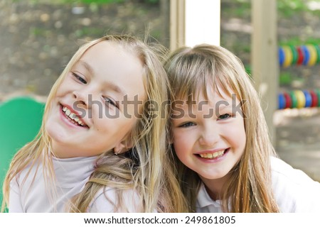 Photo of two smiling girls in summer