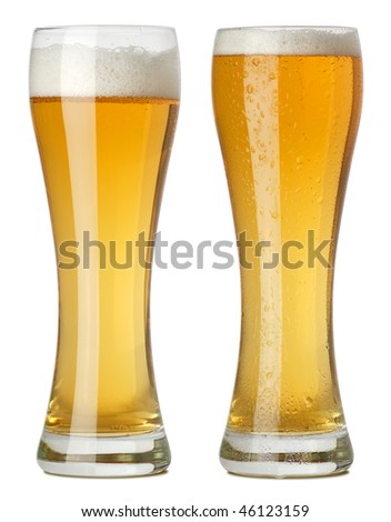 Photo of two tall glasses of beer, one with condensation and one without. Two photographs merged. - stock photo
