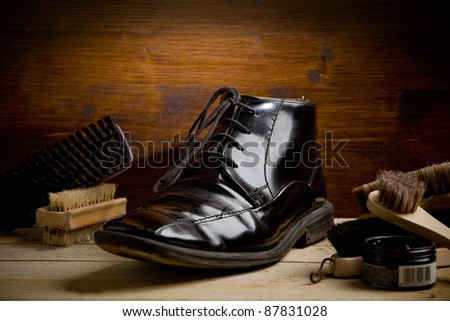 photo of various brushes on wooden table used for polishing shoes