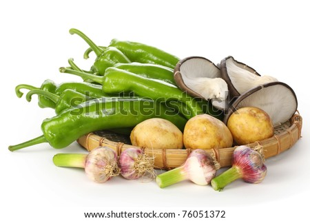 Photo of vegetables on a white background.