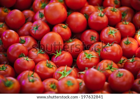 photo of very fresh tomatoes presented on white background, group of fresh tomatoes on market, in shop