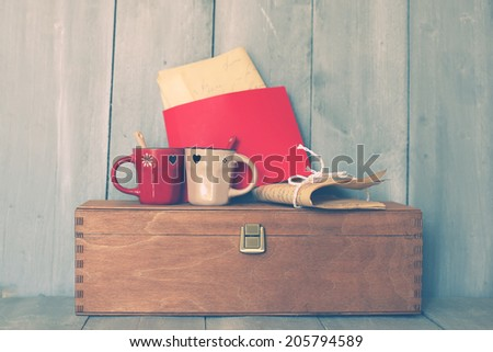 Photo of vintage box on wooden background - stock photo