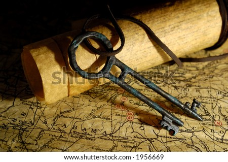 Photo of Vintage Maps and a Tresure Chest Key - Exploration Concept - stock photo