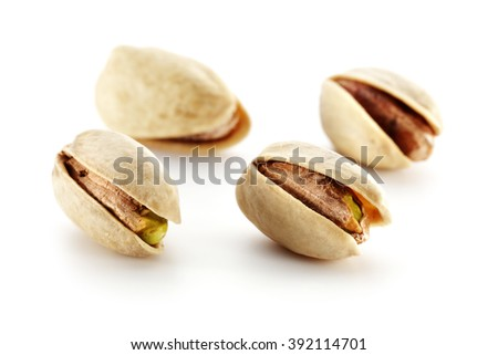 photo of white background and few pistachios