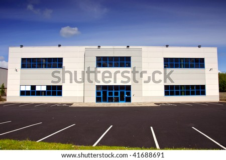 photo of white corporate office block for rent - stock photo