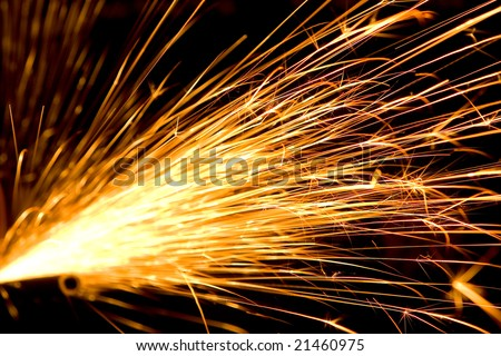 Photo of white hot sparks at grinding steel material - stock photo