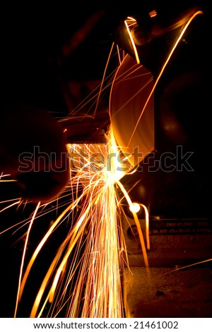 Photo of white hot sparks at grinding steel material